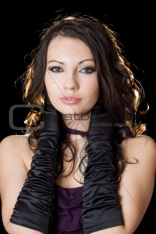 Beautiful young woman in a violet dress over black