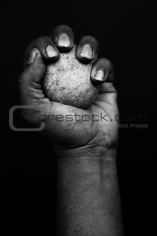 A hand and with a stone
