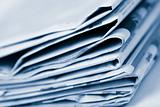 stack of newspapers toned blue