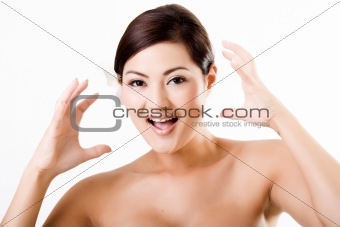 Attractive asian female showing surprised face