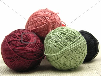 A few balls of wool  on a beige background