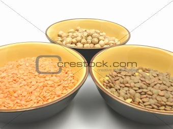Three bowls of ceramic with garbanzos lentils and red lentils
