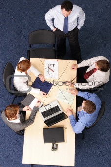 five business people meeting