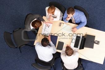 five business people meeting
