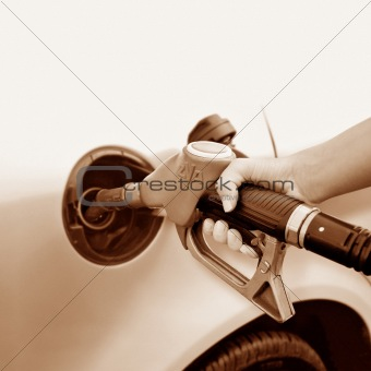 A woman's hand taking gas