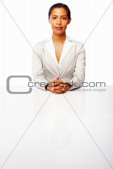 Confident young businesswoman isolated on white background