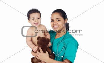 Adorable doctor with a baby in her arms
