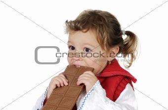 Adorable girl eating chocolate