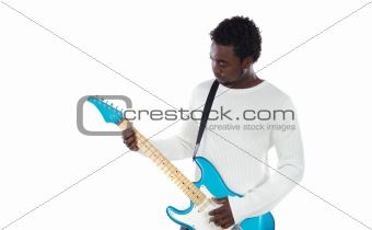 Boy playing electrical guitar