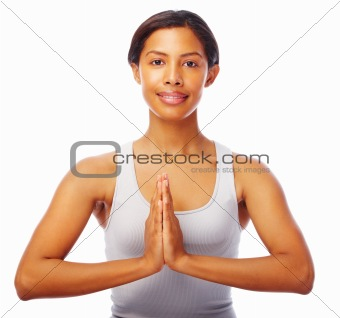 Young fit female doing yoga exercise