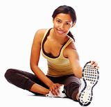 Fit young woman doing stretching exercise