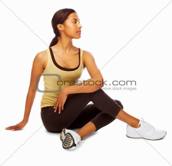 Young toned woman doing fitness exercises