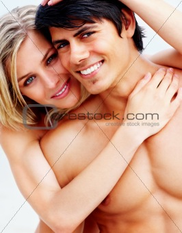 Young woman hugging her semi naked boyfriend