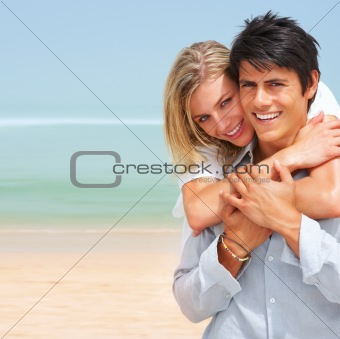 Portrait of a happy young couple at beach