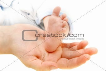 baby's foot on parents' hand