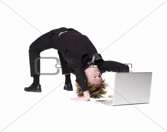 Acrobatic man in front of a computer