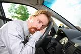 driver sleeps in a car