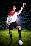 soccer player in the dark