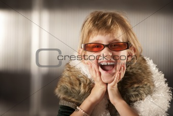 Cute young girl in red glasses