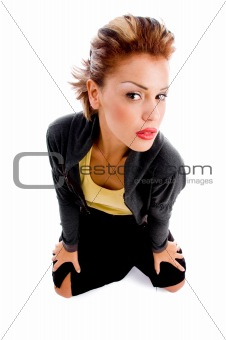 high angle view of sitting woman looking at camera