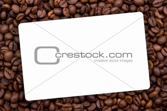 background made with coffee beans with white label