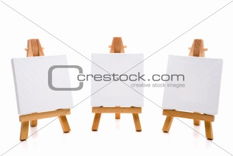 three empty white painting canvas