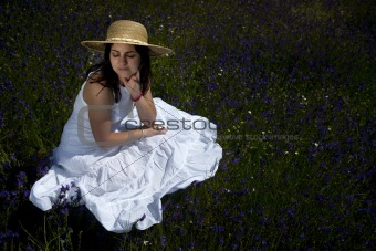 beautiful woman in white dress relaxing in the nature