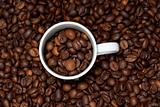 background with white cup and coffee beans