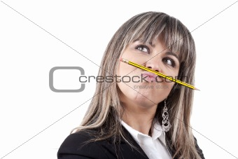 beautiful blond businesswoman holding pencil in the mouth