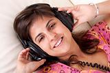 beautiful young girl with headphones listening music