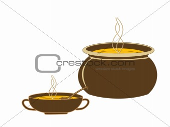 Cauldron and a mug with hot orange soup