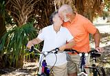 Bicycling Seniors Kiss