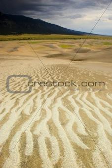 Thunderstorm over sand dunes