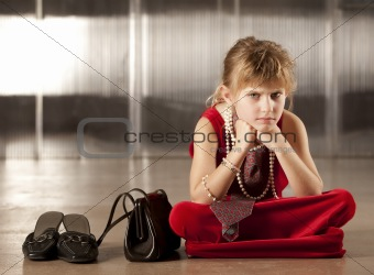 Sullen young girl in red