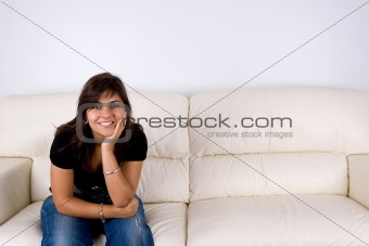 beautiful young woman with black shirt sitting in white sofa