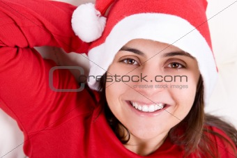 beautiful young woman with red christmas hat portrait