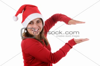 beautiful santa woman in red holding present in her hands