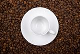 white cup over coffee bean made background