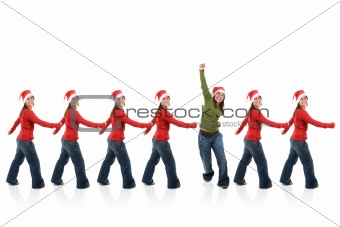 group of santa claus women in line with one breaking the pattern