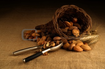 Assortment of nuts in basket with nutcracker