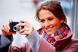 Woman clicking photographs on her digital camera
