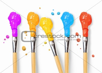 Bristle brushes full of different colored paints
