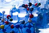 Glass in laboratory and atom