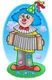 Clown with accordion on  meadow