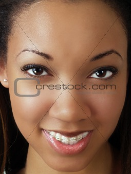 Tight closeup portrait of young black woman