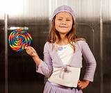 Cute young girl with lollipop