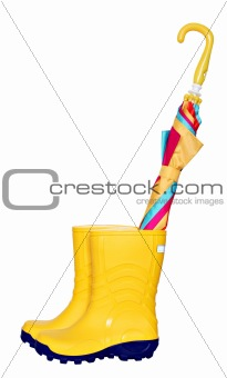 Pair of yellow rubber boots with colorful umbrella
