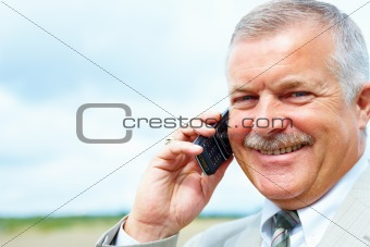 Senior businessman talking on cellphone