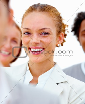 Portrait of smiling businesswoman with colleagues