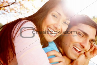 Portrait of a laughing young couple having fun